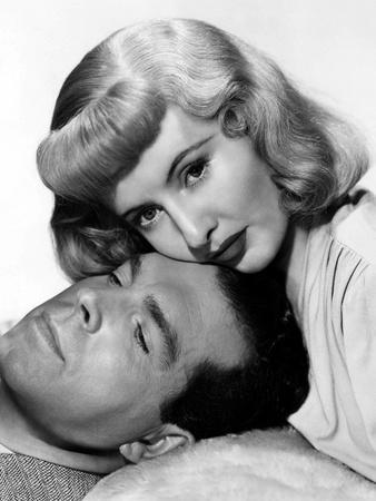 DOUBLE INDEMNITY, 1944 directed by BILLY WILDER Fred MacMurray and Barbara Stanwyck (b/w photo)
