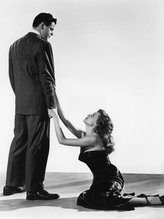 GILDA, 1946 directed by CHARLES VIDOR Glenn Ford and Rita Hayworth (b/w photo)