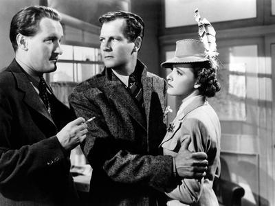 FOREIGN CORRESPONDENT, 1940 directed by ALFRED HICHCOCK George Sanders, Joel Mc Crea and Laraine De