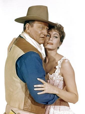 EL DORADO, 1967 directed by HOWARD HAWKS John Wayne and Charlene Holt (photo)