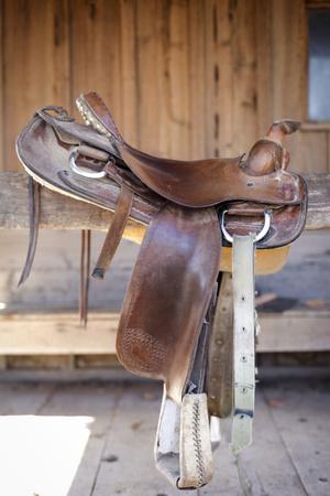 Full view of a Saddle resting on the railing, Tucson, Arizona, USA.