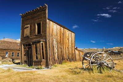 Abandoned ghost town building and wagon, Bodie State Historic Park, California, USA