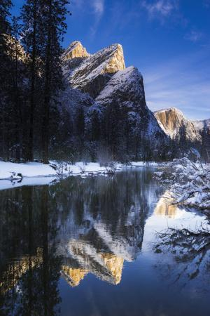 The Three Brothers above the Merced River in winter, Yosemite National Park, California, USA