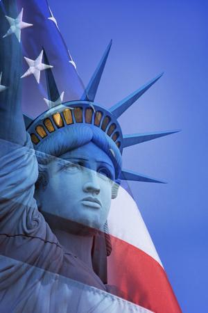 USA, Nevada, Las Vegas. Statue of Liberty and American flag composite.