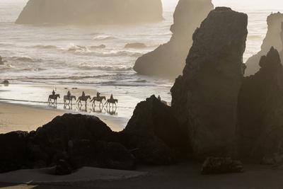 USA, Oregon, Bandon. Horseback riders on beach.