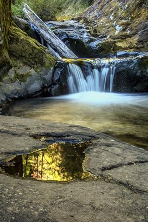 USA, Oregon, Florence. Waterfall in stream.