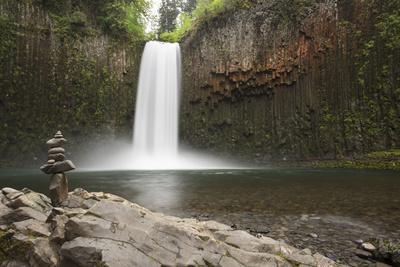 USA, Oregon. Abiqua Falls and stacked pile of rocks.
