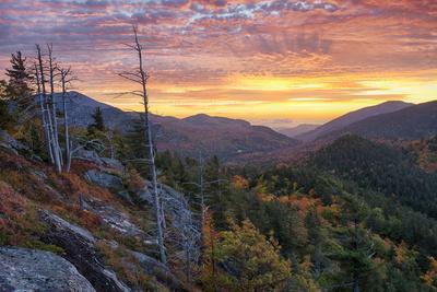 USA, New York State. Sunrise on Mount Baxter in autumn, Adirondack Mountains.