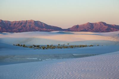 New Mexico. White Sands National Monument landscape of sand dunes and mountains