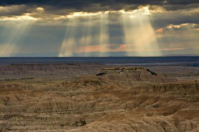 Storm at sunset, Pinnacles Viewpoint, Badlands National Park, South Dakota, USA