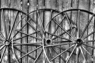 Wooden fence and old wagon wheels, Charleston, South Carolina