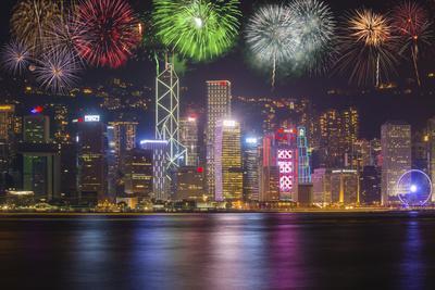 China, Hong Kong. Fireworks over city at night.