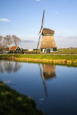Netherlands, Lisse, Windmill on a Canal