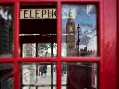 The houses of parliament reflected in an iconic red phone box in Westminster, London.