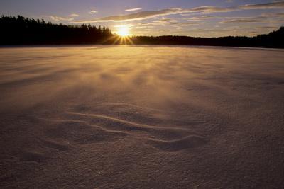 Winter sunset as seen from the frozen Walden Pond.