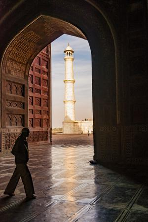 India, Uttar Pradesh. Agra. Taj Mahal minaret framed by mosque arch