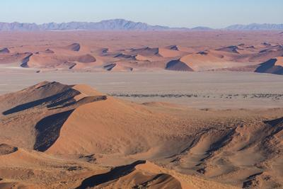 Namibia. Aerial view of the vast red dune fields of Sossusvlei in Namib-Naukluft National Park.
