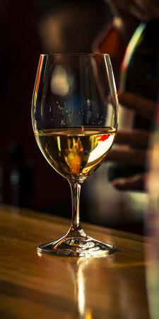 USA, Washington State, Woodinville. A glass of white wine and reflections