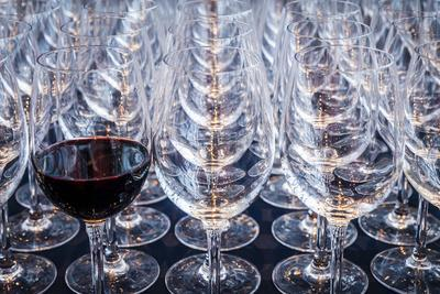 USA, Washington State, Seattle. Red wine in row of glasses.