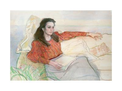 Portrait of a woman seated on a sofa