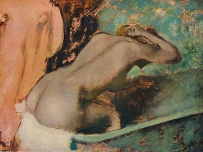 Femme assise sur le bord d'une baignoire et s'epongeant le cou, c1880, (1936)