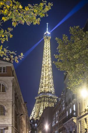 Eiffel tower in Paris street by night
