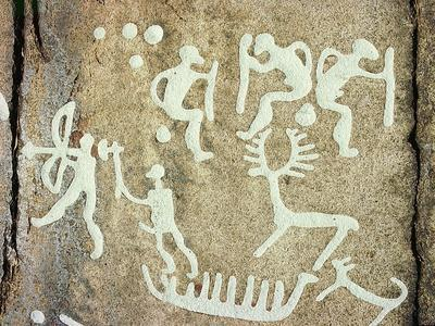 Petroglyphs; figures brandishing weapons, with a reindeer