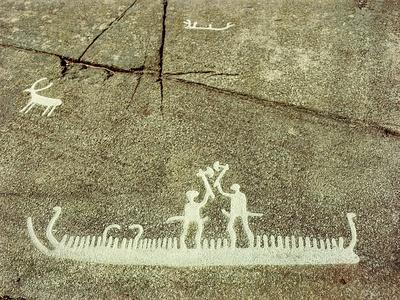 Petroglyph depicting phallic figures on board a ship, apparently performing a ceremonial axe dance