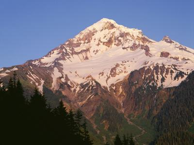 Oregon. Mount Hood NF, Mount Hood Wilderness, evening light on west side of Mount Hood