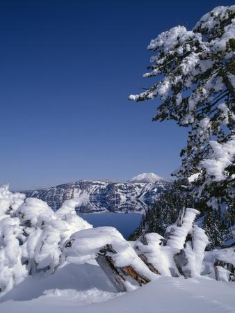Oregon, Crater Lake National Park. Winter snow accumulates at Crater Lake