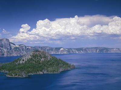 USA, Oregon. Crater Lake National Park, thunder clouds float over Wizard Island and Crater Lake.