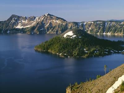 Oregon. Crater Lake NP, sunrise on Crater Lake and Wizard Island with Garfield Peak
