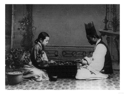 Korean Man and Woman Playing a Game Photograph - Korea