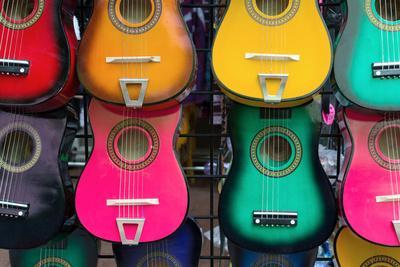 Acoustic Guitars on Wall