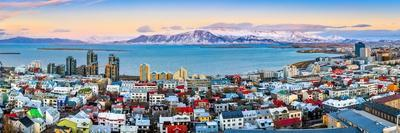 Aerial Panorama of Downtown Reykjavik at Sunset with Colorful Houses and Snowy Mountains in the Bac