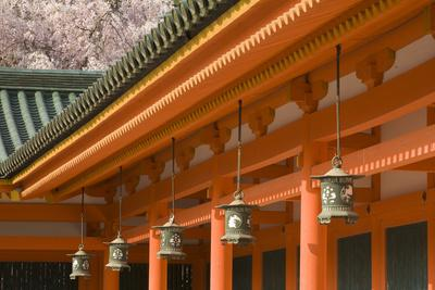 Japan, Honshu island, Kyoto, bronze lanterns and orange pillars of Heian Jingu Shrine