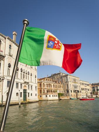Italy, Venice, Italian flag with Naval ensign flying above Grand Canal.