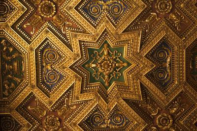 Italy, Rome, Trastevere, ornate gold ceiling in cathedral.
