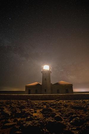 Spain, Menorca. Milky Way over the lighthouse.