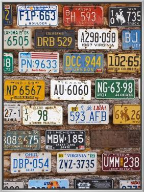 Hole in the Rock Tourist Shop With Old License Plates, Moab, Utah, USA by Walter Bibikow